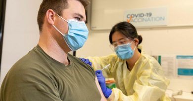 Trooper Jack Calcino receives a COVID-19 vaccine from registered nurse Daisy Hwang at the Royal Adelaide Hospital. Photo by Leading Aircraftman Stewart Gould.