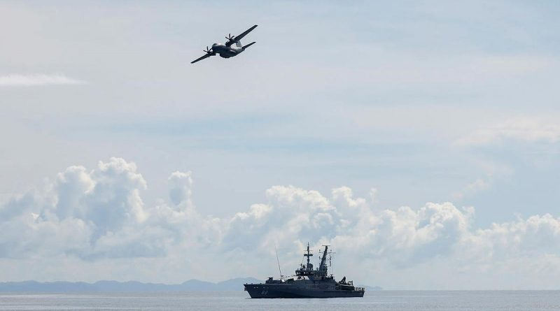 A Royal Australian Air Force C-27J Spartan flies over HMAS Maitland off the coast of Honiara, Solomon Islands, during a maritime surveillance patrol for illegal fishing activity on Operation Solania. Photo by FLTLT Peter Spearman.
