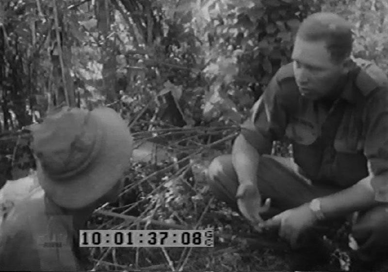 Captain Sandy MacGregor briefs a 'tunnel rat' on Operation Enoggera.