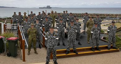 HMAS Choules Commanding Officer Commander Ben Reilly, members of his crew and their ship at Mallacoota to announce that the Victorian town was the ship's new ceremonial homeport. Photo by Leading Seaman Leo Baumgartner.