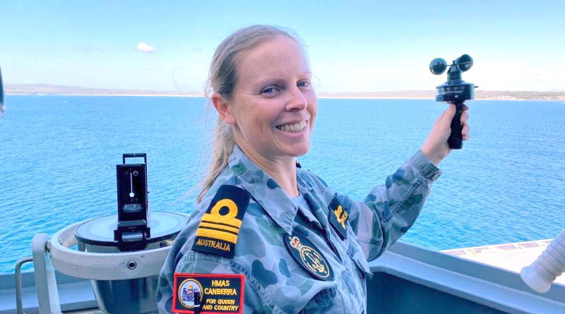 Meteorologist and oceanographer Lieutenant Commander Fiona Simmonds uses an anemometer to measure wind speed aboard HMAS Canberra in Jervis Bay.