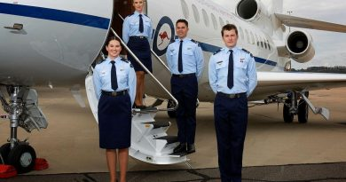 Crew attendants Leading Aircraftwoman Sophie Noonan, left, Leading Aircraftwoman Madeleine Braz, Leading Aircraftman Josh Lenard and Leading Aircraftman Jack Young on graduation day in front of the Dassault Falcon 7X. Photo by Sergeant Oliver Carter.
