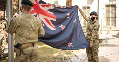 New Zealand Defence Force personnel lower the New Zealand National Flag in Kabul for the last time. NZDF photo.
