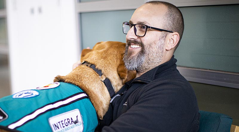 Ben Jones and his new psychiatric assistance dog Belle. Photo supplied.