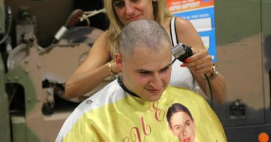 Trooper Darius Kaveh-Ahangari has his head shaved as part of Shave for a Cure.