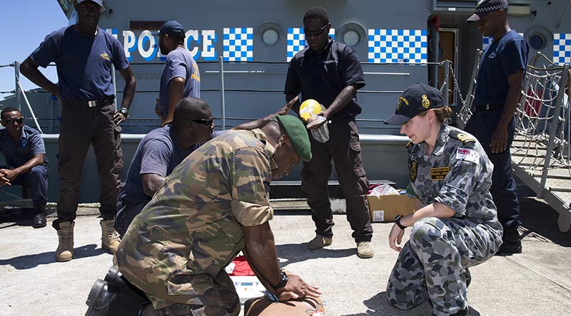 Royal Australian Navy Lieutenant Rhianna Jones teaches CPR to police officers from the Vanuatu Police Force Maritime Wing and Vanuatu Mobile Ground Forces soldiers in Port Villa, Vanuatu. Photo by Sergeant Ray Vance.