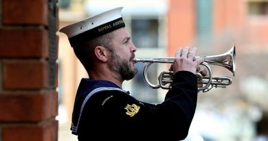 Leading Seaman Musician Marcus Salone plays the Last Post during a memorial service held on completion of the Freedom of Entry at the Bathurst War Memorial. Story by Sebastian Beurich.
