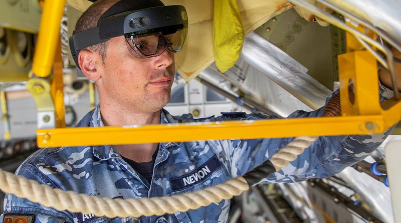 Avionics Technician, Corporal Joshua Newbon from No. 36 Squadron, utilises the Hololens mixed reality device during maintenance of a C-17A Globemaster III aircraft. Story by Samara Kitchener. RAAF file photo.