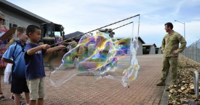 Children of soldiers of the 1st Combat Engineer Regiment make bubbles during the regiment's family day.