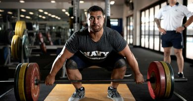 Weightlifter Leading Seaman Suamili Nanai trains at HMAS Stirling in Western Australia under the watchful eye of Leading Seaman Physical Training Instructor Jakob Pekolj. Photo by Petty Officer Yuri Ramsey.