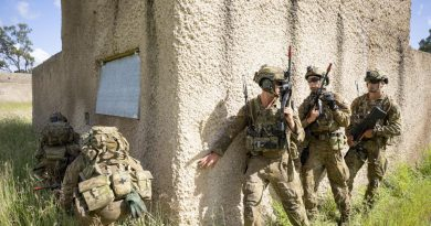 Soldiers from the 3rd Combat Engineer Regiment prepare to enter a compound during Exercise Dingo Fury at Townsville Field Training Area. Photo by Corporal Brendon Grey.