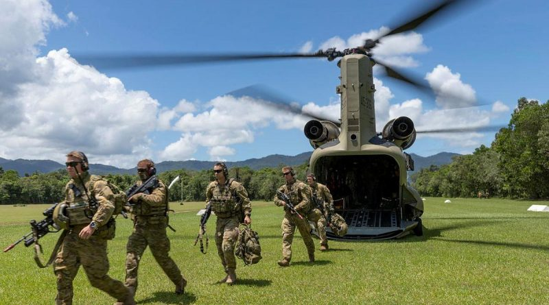 Soldiers from the 3rd Battalion exit a CH-47 Chinook during air mobile and stability operations training at the Combat Training Centre - Jungle Training Wing, Tully, Queensland. Photo by Corporal Brandon Grey.
