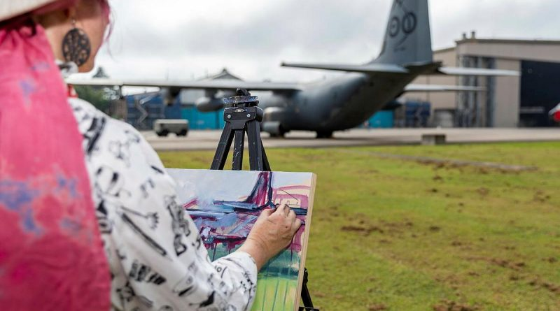 Mellissa Read-Devine, of the Ferry Artists Gallery, paints a RAAF C-130J on canvas with acrylic during the RAAF Base Richmond Artists' Day. Photo by Corporal Dan Pinhorn.