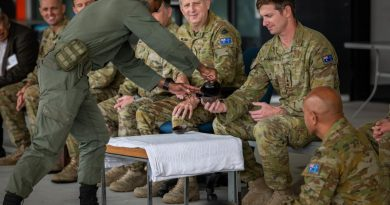 Private Sireli Levukaiciwa from the Republic of Fiji Military Forces gives Kava to the Commanding Officer of 8th/9th Battalion, the Royal Australian Regiment, Lieutenant Colonel John Eccleston. Photo by Private Jacob Hilton.