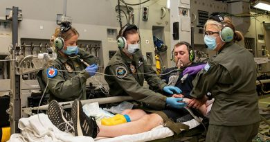 Corporal Kate Fox, left, Sergeant Fiona Jackson and Flight Lieutenant Susan Coretti treat a simulated patient during an Aeromedical Evacuation Training Exercise on board a C-17 Globemaster III. Photo by Leading Aircraftwoman Emma Schwenke.