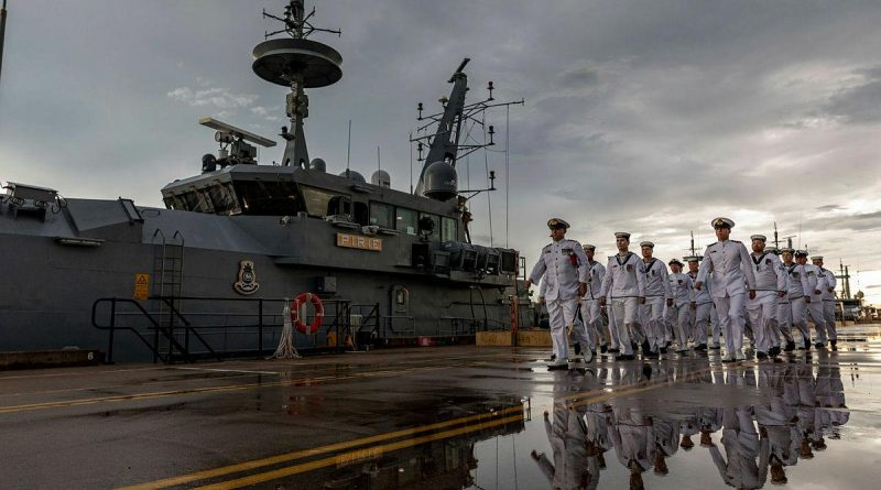 Commanding Officer HMAS Pirie Lieutenant Commander Sean Dalton leads the ship's company as they march off after the patrol boat's decommissioning at HMAS Coonawarra in Darwin. Photo by Leading Seaman Shane Cameron.