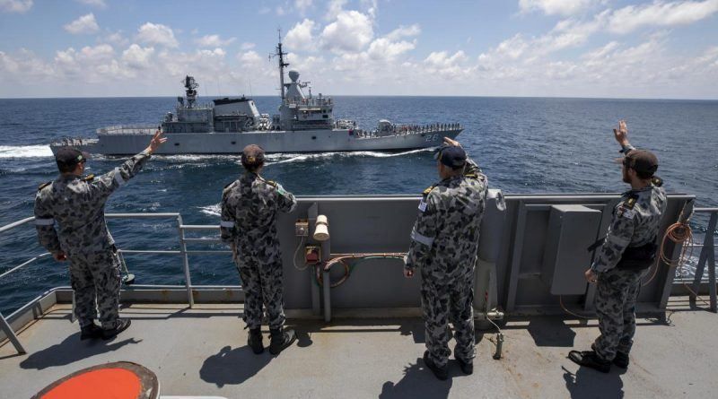Members of HMAS Sirius' ship's company wave to the crew of Royal Malaysian Navy ship KD Lekir in the Andaman Sea. Photo by Leading Seaman Thomas Sawtell.