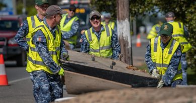 Air Force personnel remove flood-damaged items from local homes and streets in Port Macquarie during Operation NSW Flood Assist. Photo by Private Jacob Hilton.
