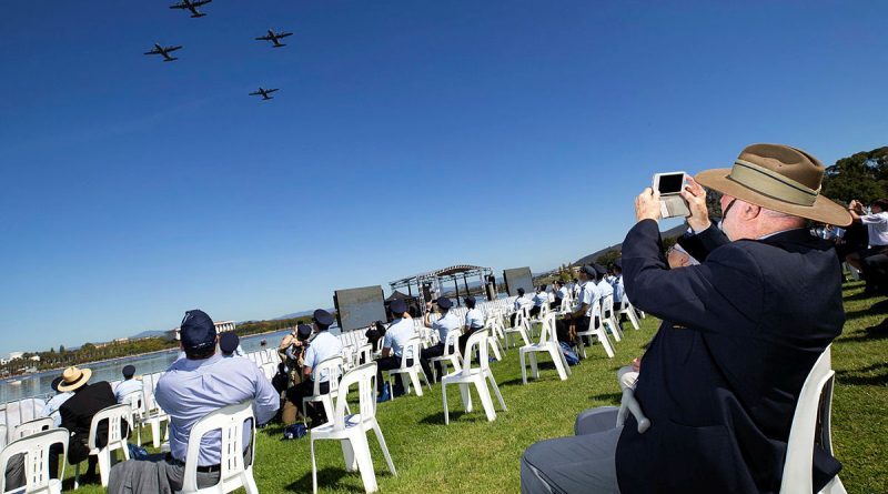 Royal Australian Air Force veteran Mr Alan Sullivan takes photos of Royal Australian Air Force aircraft flying over Rond Terrace, Canberra during the Air Force 2021 Centenary flyover. Photo by Cpl David Said.