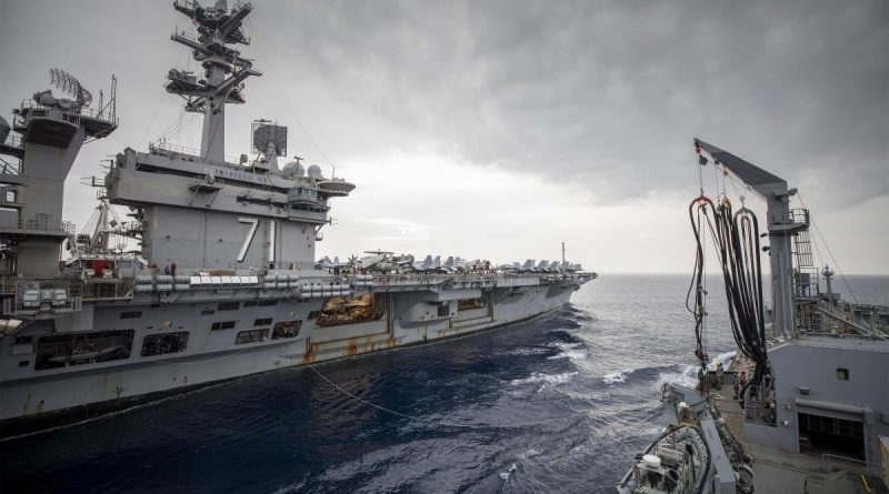 HMAS Sirius conducts a replenishment at sea with USS Theodore Roosevelt. Photo by Leading Seaman Thomas Sawtell.