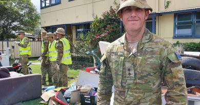 Lieutenant Kurt O'Neill, attached to the 2nd Combat Engineer Regiment, with his platoon help residents clean up after the flood at Laurieton.