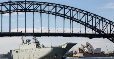 HMAS Adelaide sails under the Sydney Harbour Bridge to conduct a ship's pilotage exercise in Sydney, New South Wales. Story by Lieutenant Commander Christopher Thornton. Photo by Leading Seaman IS Tara Morrison.
