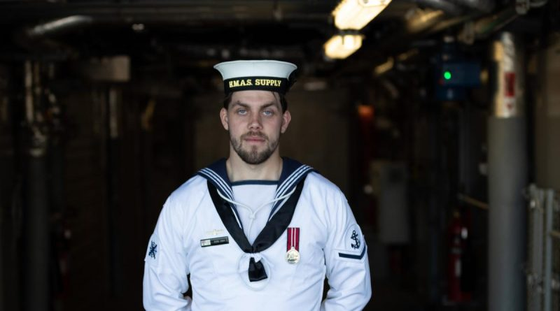 Leading Seaman Dion Cray on board HMAS Supply. Story by Lieutenant Jessica Craig. Photo by Leading Seaman David Cox.