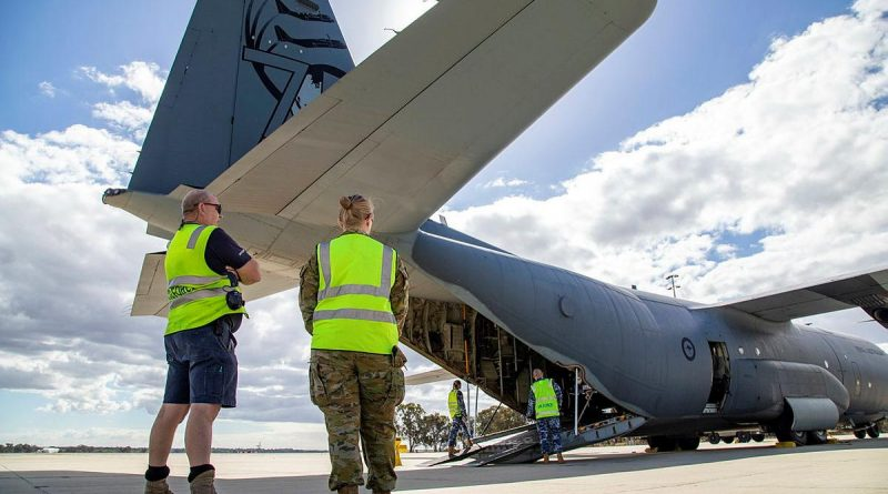 Sergeant John Braken (left) and Corporal Amber Nichols observe the loading of a C-130J Hercules at RAAF Base Pearce as part of Defence's support to the WA Government following Tropical Cyclone. Photo by Petty Officer Yuri Ramsey.