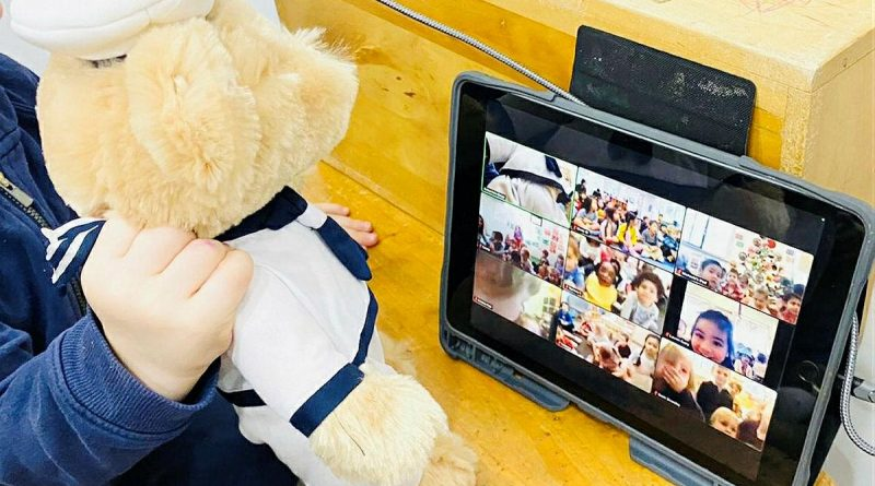 CAPTION: A Navy teddy is held by a child from the Vaucluse Cottage Childcare Centre in Sydney, during a Zoom call to sister preschools. Story by Lieutenant Kiz Welling-Burtenshaw. Photo by Emma Wholihan.