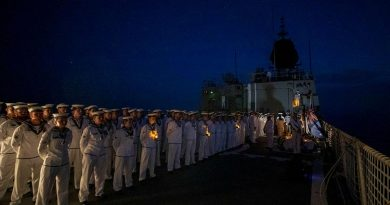 HMAS Anzac personnel conduct an Anzac Day ceremony in the South China Sea. Story by Lieutenant Geoff Long. Photo by Leading Seaman Thomas Sawtell.