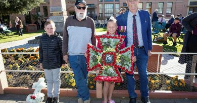 """Relatives of Ordinary Seaman Edward """"Teddy"""" Sheean, VC prepare to lay a wreath at an Anzac Day Service in Latrobe, Tasmania. From left, Mr Andrew Jarvie, Mr Ted Sheean, Miss Bella Sheean and Mr Garry Ivory. Story by Lieutenant Jessica Craig. Photo by Petty Officer Tom Gibson."""