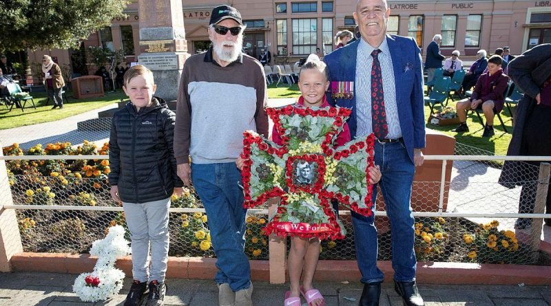 "Relatives of Ordinary Seaman Edward ""Teddy"" Sheean, VC prepare to lay a wreath at an Anzac Day Service in Latrobe, Tasmania. From left, Mr Andrew Jarvie, Mr Ted Sheean, Miss Bella Sheean and Mr Garry Ivory. Story by Lieutenant Jessica Craig. Photo by Petty Officer Tom Gibson."