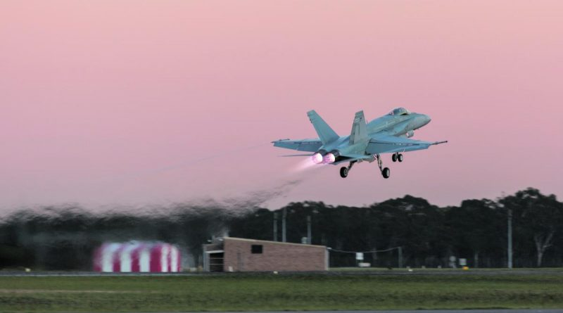 CAPTION: An Air Force F/A-18A Hornet takes off from RAAF Base Williamtown. Story by Flight Sergeant Josa Kohler. Photo by Sergeant David Gibbs