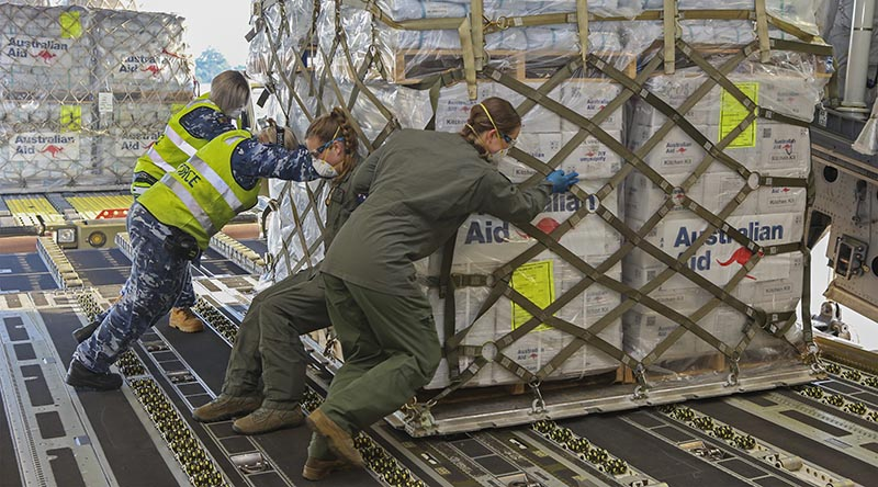 Royal Australian Air Force Air Movements Operators from No. 23 Squadron and No. 36 Squadron loadmasters, load a pallet of humanitarian aid on board a 36SQN C-17A Globemaster. Photo by Corporal Jesse Kane.