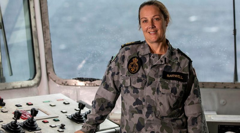 Petty Officer Hayley Barwell in the replenishment-at-sea control room on HMAS Sirius. Story by Lieutenant Geoff Long. Photo by Leading Seaman Thomas Sawtell.