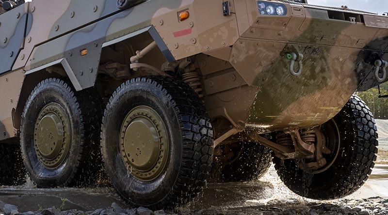 An Australian Army Boxer conducts a water crossing at Greenbank Training Area during a drivers' course. Cropped segment from a Corporal Nicole Dorrett photo.