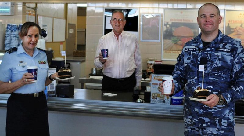 Veteran Paul Beraldo with Squadron Leaders Robyn Connell and Dane Johnson inside the Army and Air Force Canteen Service at RAAF Laverton.