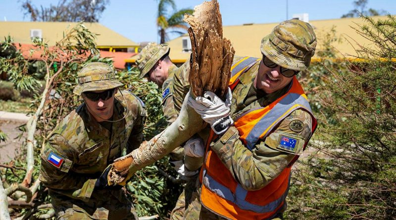 Privates Jordan Stidworthy, left, and Jarryd Kirby remove fallen branches and debris from Northampton District High School after Tropical Cyclone Seroja. Story by Captain Zoe Griffyn. Photo by Leading Seaman Kieren Whiteley.