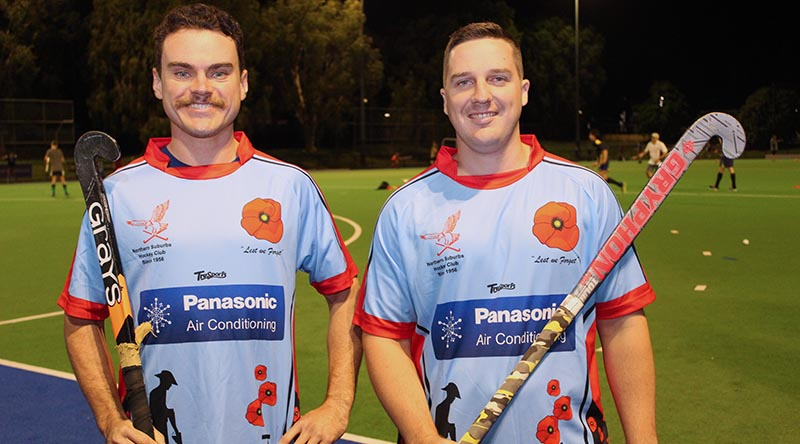 Norths Hockey Club players Jack Tucker and Australian Army Craftsman Peter Hamilton, of Gallipoli Barracks in Brisbane, wearing the special Diggers Appreciation Day jerseys.