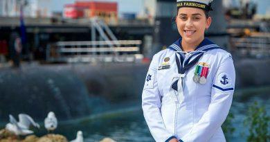 Leading Seaman Elizabeth McCallum in front of HMAS Collins at Fleet Base West in Rockingham, WA. Story by Lieutenant Rilana Ostheim. Photo by Leading Seaman Richard Cordell.