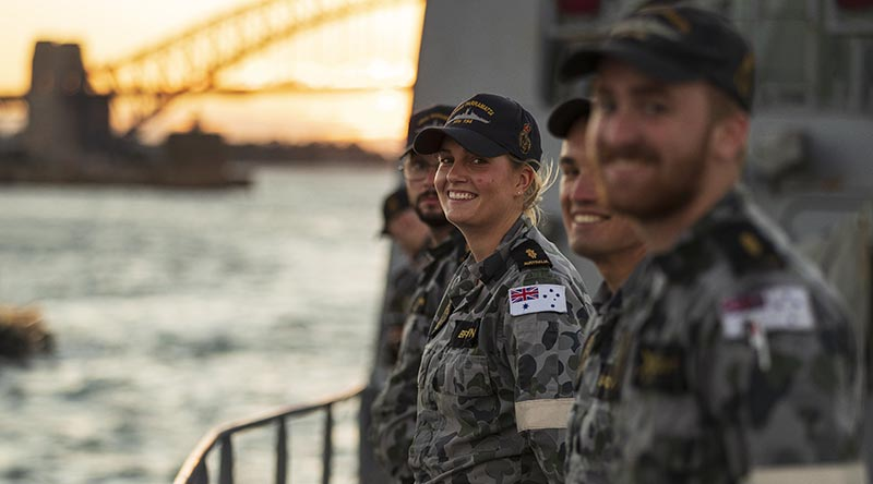 Able Seaman Claire Brown is all smiles as HMAS Parramatta departs Fleet Base East on Sydney Harbour for a two-month deployment to south-east and north-east Asia. Photo by Leading Seaman Jarrod Mulvihill.