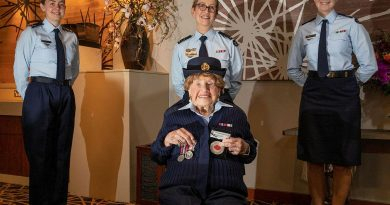 Leading Aircraftwoman Carley Dunn, left, Squadron Leader Del Gaudry, and Corporal Maddison Henry stand with Mrs Iris Terry during a formal presentation of a uniform at the Fairfield RSL. Story by Eamon Hamilton. Photo by Corporal Kylie Gibson.