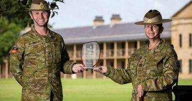 Commander Forces Command Major General Matthew Pearse and Command Sergeant Major Warrant Officer Class One Kim Felmingham hold the trophy on behalf of Army at Victoria Barracks, Sydney. Story by Private Jacob Joseph. Photo by Sergeant Nunu Campos.