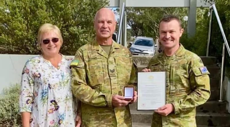 Sergeant Andrew Turner, accompanied by wife Susan, is presented with a Federation Star for 40 years service in the Australian Defence Force, by Commander Forces Command Major General Matt Pearse. Photo supplied by family.