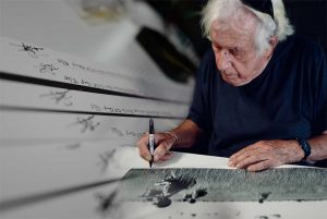 Legendary Vietnam photographer Tim Page signs some of his limited-edition prints to raise money for veteran charities.