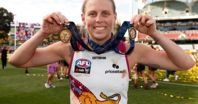 Corporal Kate Lutkins celebrates after winning the best-on-ground award during the 2021 AFLW grand final match. Story by Sergeant Sebastian Beurich. Photo by Michael Willson/AFL Photos.