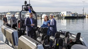 The Whiskey Project executives Ryan Carmichael and Daren Schuback show Minister for Defence Industry Melissa Price their tactical watercraft at Garden Island in Sydney. Photo by Able Seaman Benjamin Ricketts.