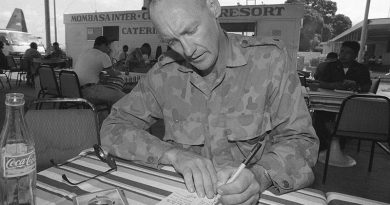 Officer Commanding BASG at Baidoa, Somalia, takes time out to write a postcard home. Photo by Corporal Gary Ramage.