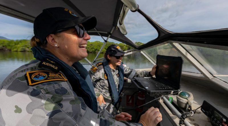 Able Seaman Deneki Stewart, right, and Leading Seaman Tanya Maksimovic conduct surveying operations in Chinaman Creek in Cairns. Story by Sub-Lieutenant Nancy Cotton. Photo by Leading Seaman Shane Cameron.