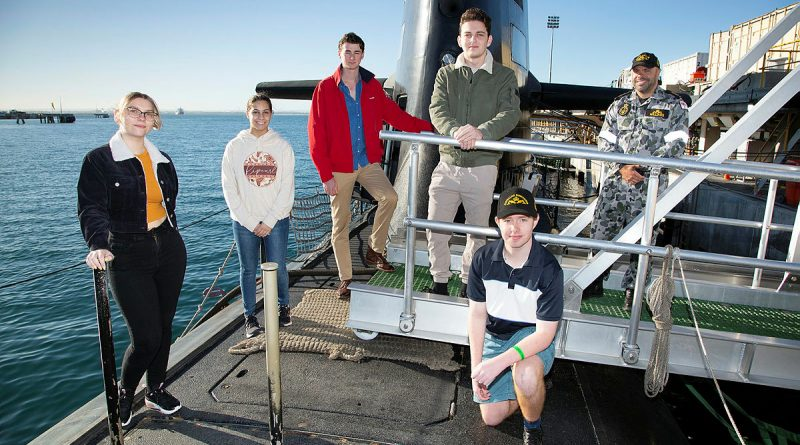 (L-R) National Submarine Tour and Competition winners stand with Petty Officer Maritime Logistics-Chef Submarines Erol Williams from the Submarine Recruiting Team on HMAS Collins at Fleet Base West in Western Australia. Story by Carrie Robards. Photo by Chief Petty Officer Damian Pawlenko.